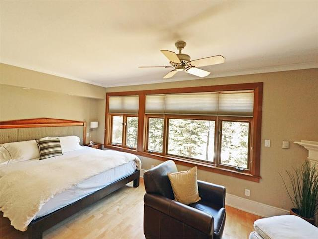 <p><span>31 River Drive South, Bragg Creek, Alta.</span><br> There are two bedrooms in the home.<br> (Photo: Zoocasa) </p>