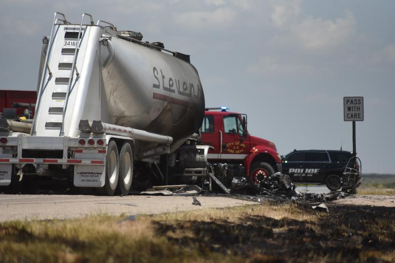 Grass along New Mexico State Route 128 near Jal shows burn marks following a fatal head-on crash Thursday, July 11, 2019. Authorities say four oilfield workers traveling in a pickup truck and the driver of a big rig were pronounced dead at the scene. (Jason Farmer/The Hobbs Daily News-Sun via AP)