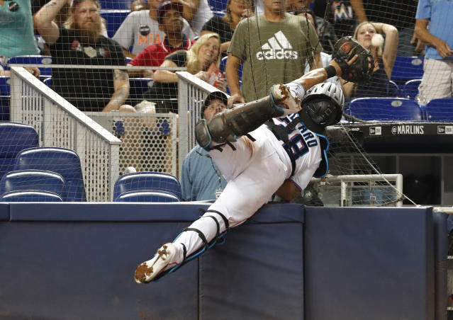 Miami Marlins catcher Jorge Alfaro (38) attempts to catch a foul ball hit by San Diego Padres' Francisco Mejia during the inning a baseball game, Tuesday, July 16, 2019, in Miami. (AP Photo/Wilfredo Lee)