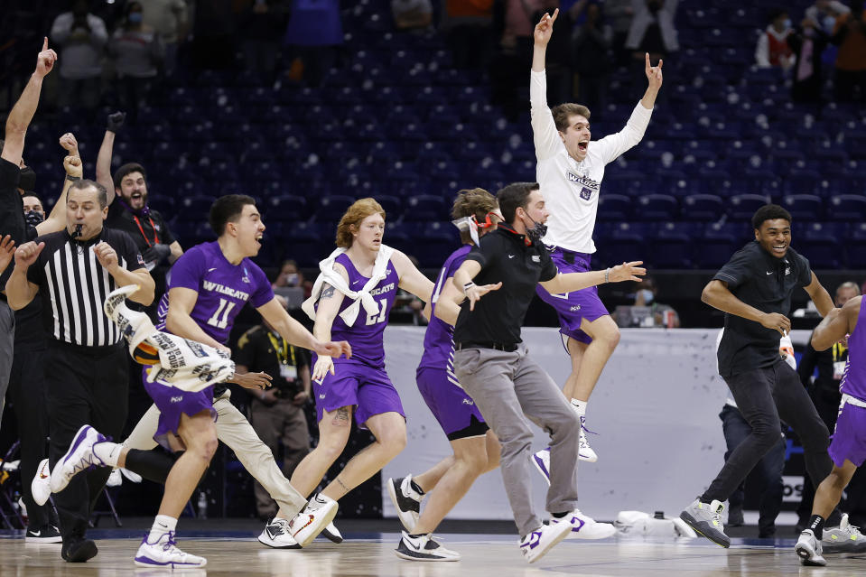 INDIANAPOLIS, INDIANA - MARCH 20: Abilene Christian Wildcats celebrate after defeating Texas Longhorns 53-52 in the first round game of the 2021 NCAA Men's Basketball Tournament at Lucas Oil Stadium on March 20, 2021 in Indianapolis, Indiana. (Photo by Jamie Squire/Getty Images)