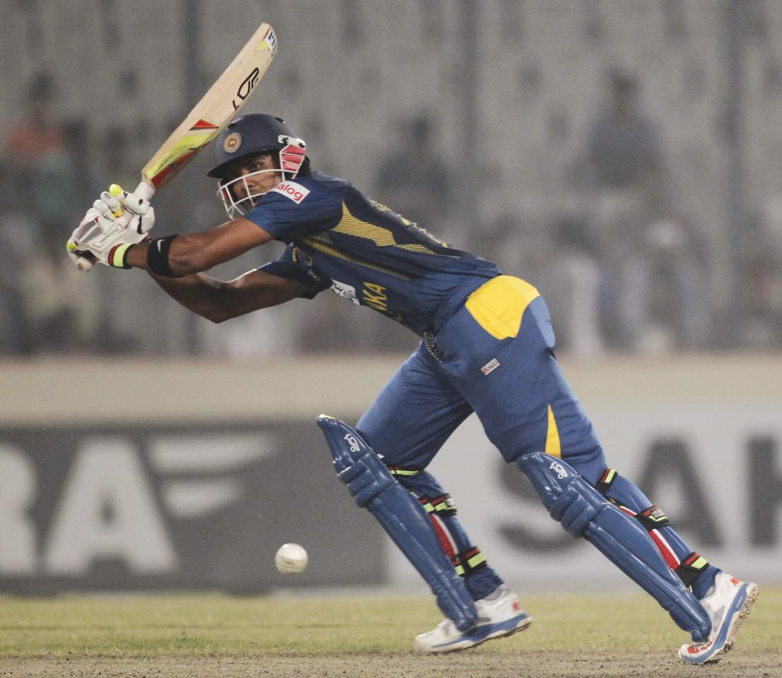 Sri Lanka's Dinesh Chandimal plays a ball against Bangladesh during their third one day international (ODI) cricket match of the series in Dhaka February 22, 2014. REUTERS/Andrew Biraj (BANGLADESH - Tags: SPORT CRICKET)