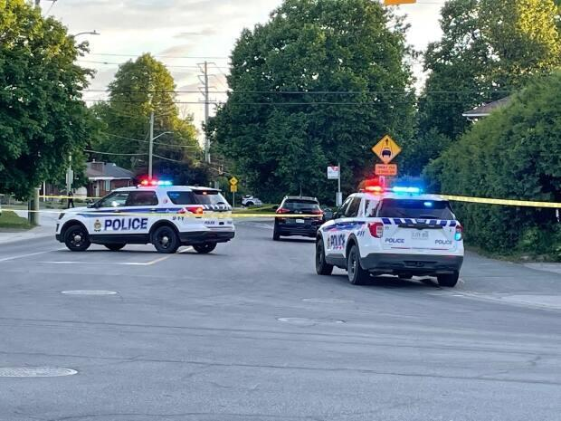 Ottawa police vehicles parked at the scene of a shooting on Woodroffe Avenue near Baseline Road on Sunday night. Police say one person was taken to the hospital.