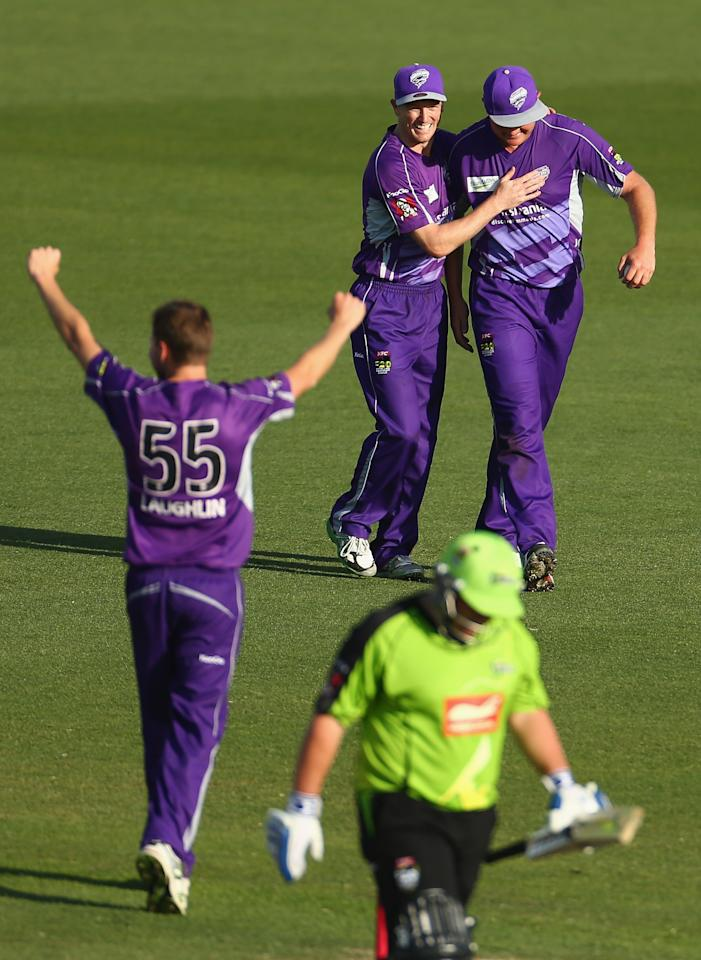 HOBART, AUSTRALIA - DECEMBER 23: Ben Laughlin of the Hurricanes celebrates the wicket of Mark Cosgrove of the Thunder caught by Doug Bollinger  during the Big Bash League match between the Hobart Hurricanes and the Sydney Thunder at Blundstone Arena on December 23, 2012 in Hobart, Australia.  (Photo by Robert Cianflone/Getty Images)