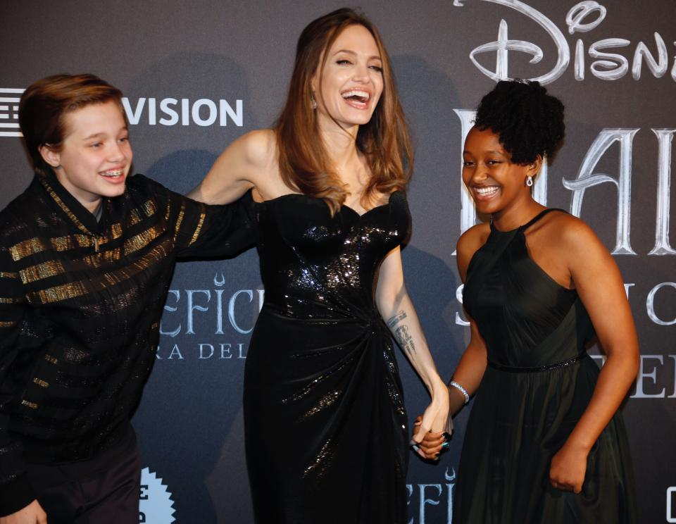 Actress Angelina Jolie arrives with her daughter Maddox Chivan, right, and son Shiloh, for the European premiere of the film 'Maleficient: mistress of evil', in Rome, Monday, Oct. 7, 2019. (AP Photo/Domenico Stinellis)