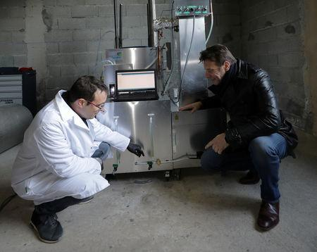 Christofer Costes, a French inventor who created a machine that turns plastic waste into fuel talks with French actor and Founder of Earthwake association, Samuel Le Bihan in Puget-Theniers, France, December 14, 2018. Picture taken December 14, 2018. REUTERS/Eric Gaillard