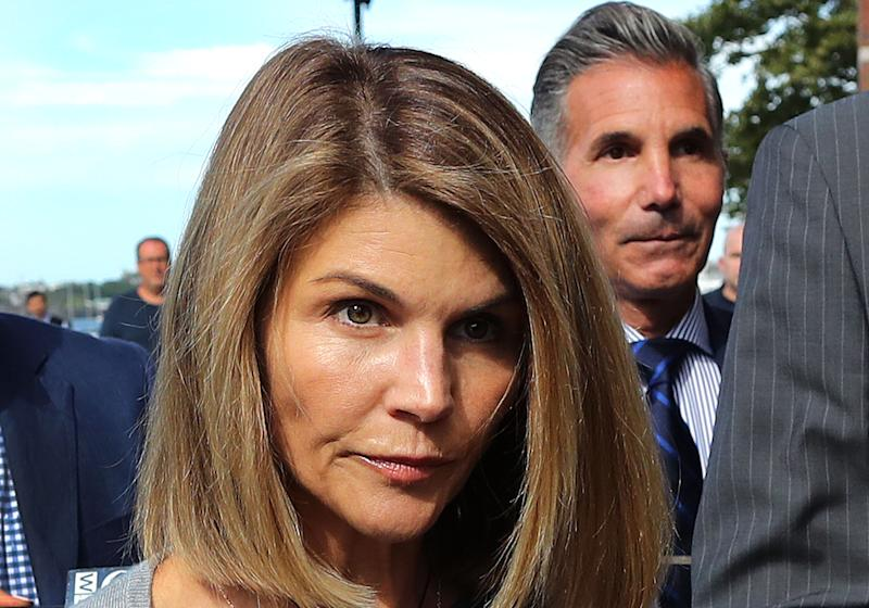 BOSTON, MA - AUGUST 27: Lori Loughlin and her husband Mossimo Giannulli, right, leave the U.S. courthouse in Boston on August 27, 2019. A judge says that actress Lori Loughlin and her husband, fashion designer Mossimo Giannulli, can continue to use a law firm that recently represented the University of Southern California. The couple appeared before the federal court in Boston on Tuesday to resolve a dispute over the choice of lawyers in a major bribery case for college admissions. Prosecutors had said that their lawyers represent a potential conflict of interest. Loughlin and Giannulli say that the companies working for USC had nothing to do with the licensing case and were handled by various lawyers. (Photo by John Tlumacki / The Boston Globe via Getty Images)