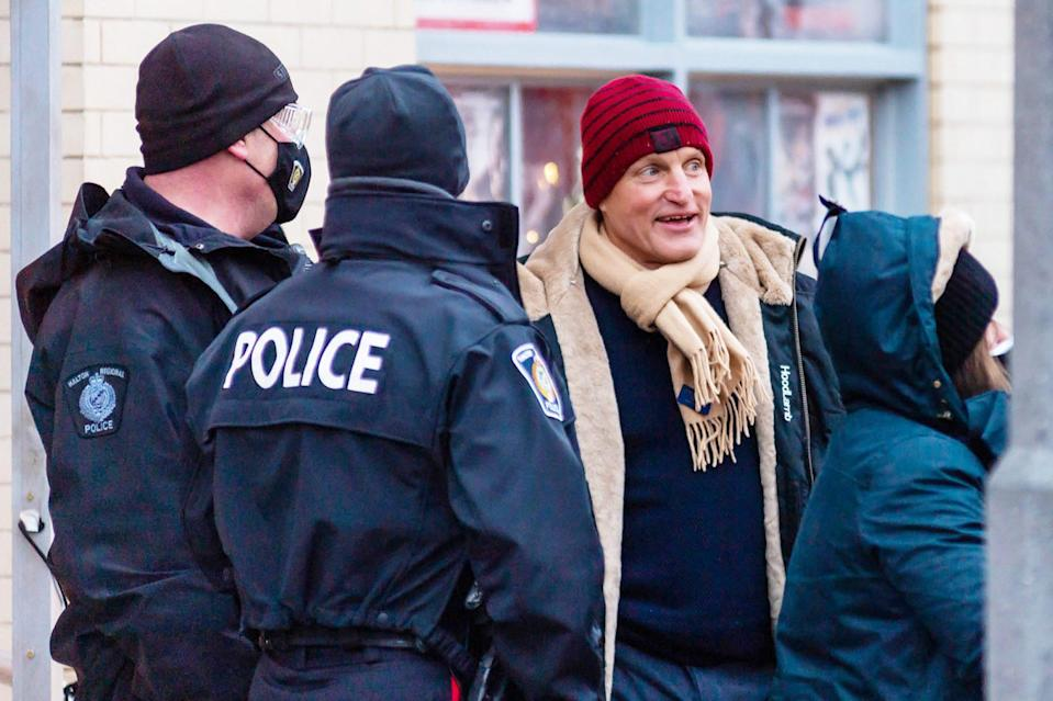 <p>Woody Harrelson talks to the crew and local police while on the set of <em>The Man From Toronto </em>on Monday in Toronto, Canada.</p>