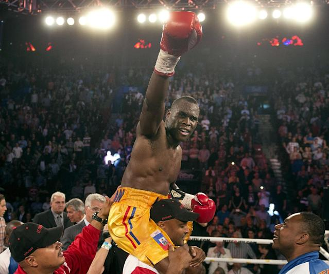 Adonis Stevenson, from Montreal, celebrates after defeating Tavoris Cloud, of the United States, for Stevenson's WBC light heavyweight title, in a boxing bout Saturday, Sept. 28, 2013, in Montreal. (AP Photo/The Canadian Press, Ryan Remiorz)