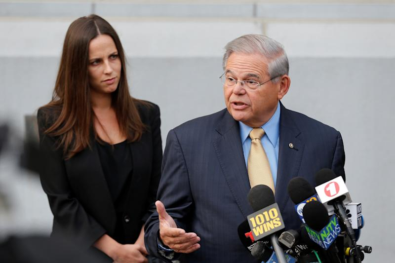 Sen. Bob Menendez speaks to journalists on Tuesday outside United States District Court for the District of New Jersey in Newark, New Jersey, after arriving to face trial for federal corruption charges. His daughter Alicia Menendez looks on.