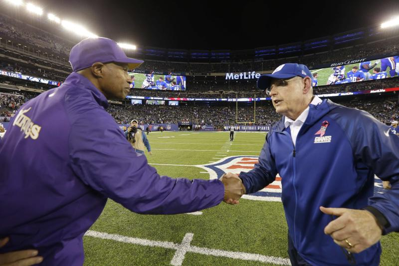 Minnesota Vikings head coach Leslie Frazier, left, shakes hands with New York Giants head coach Tom Coughlin after an NFL football game Monday, Oct. 21, 2013 in East Rutherford, N.J. The Giants won the game 23-7. (AP Photo/Julio Cortez)