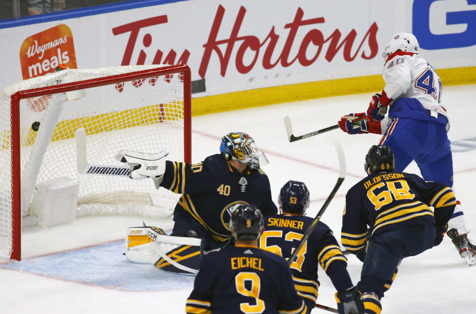 Buffalo Sabres goalie Carter Hutton (40) gives up a goal to Montreal Canadiens forward Joel Armia (40) during the first period of an NHL hockey game Wednesday, Oct. 9, 2019, in Buffalo, N.Y. (AP Photo/Jeffrey T. Barnes)