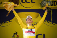 Slovenia's Tadej Pogacar, wearing the overall leader's yellow jersey, celebrates on the podium after the fifteenth stage of the Tour de France cycling race over 191.3 kilometers (118.9 miles) with start in Ceret and finish in Andorra-la-Vella, Andorra, Sunday, July 11, 2021. (AP Photo/Christophe Ena)