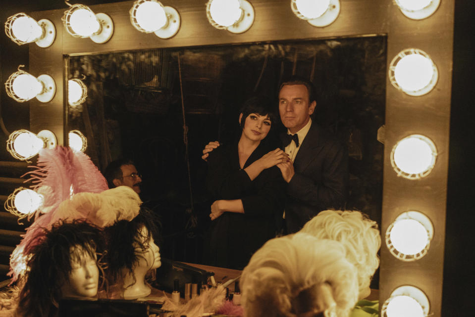 """This image released by Netflix shows Krysta Rodriguez, left, and Ewan McGregor in a scene from """"Halston."""" (Atsushi Nishijima/Netflix via AP)"""