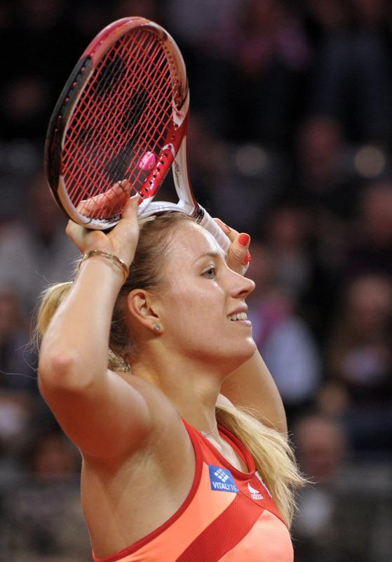 Germany's Angelique Kerber gestures during her match against Australia's Olivia Rogowska at the Fed Cup play-off tie between Germany and Australia in Stuttgart, on April 22, 2012. Kerber won 6-3, 6-3. AFP PHOTO / MARIJAN MURAT GERMANY OUT