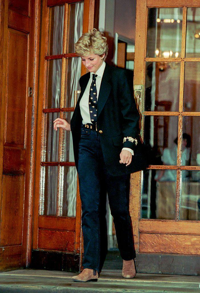 <p>Diana took this menswear-inspired look to the next level by pairing her blazer with a tie. She wore the ensemble to visit her newborn nephew, Louis Spencer, at the hospital in March 1994. </p>