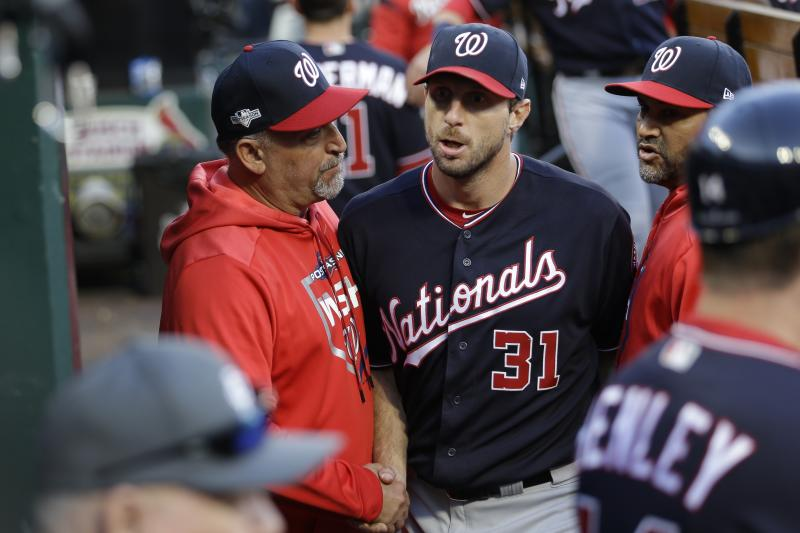 Washington Nationals manager Dave Martinez congratulates starting pitcher Max Scherzer after getting through the seventh inning of Game 2 of the baseball National League Championship Series against the St. Louis Cardinals Saturday, Oct. 12, 2019, in St. Louis. (AP Photo/Mark Humphrey)