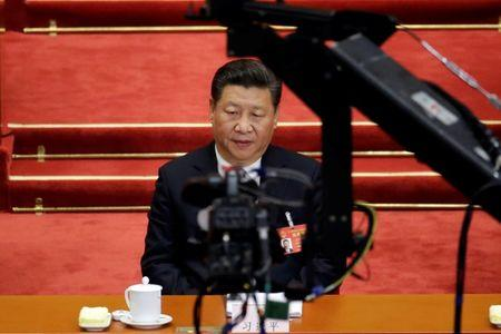 Camera is seen in front of China's President Xi Jinping attending the second plenary session of the National People's Congress (NPC) at the Great Hall of the People in Beijing