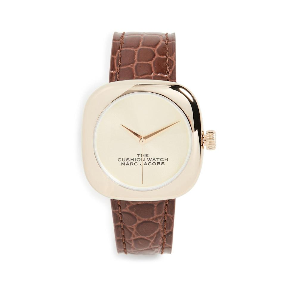 """What would this watch list be without a croc-embossed leather strap? Marc Jacobs does it again with this retro-inspired piece. $300, Shopbop. <a href=""""https://www.shopbop.com/cushion-watch-marc-jacobs/vp/v=1/1566650214.htm"""" rel=""""nofollow noopener"""" target=""""_blank"""" data-ylk=""""slk:Get it now!"""" class=""""link rapid-noclick-resp"""">Get it now!</a>"""