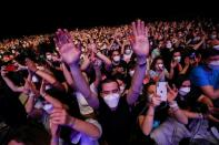 People attend first massive concert since the beginning of COVID-19 pandemic in Barcelona