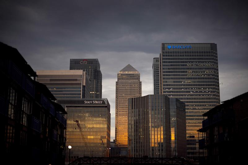 The early morning sun reflects on the financial buildings of Canary Wharf in east London. (Photo by Victoria Jones/PA Images via Getty Images)