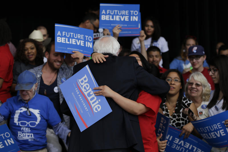 Democratic presidential candidate Sen. Bernie Sanders, I-Vt., gets a hug from a supporter at a Nevada caucus watch party in Henderson, Nev., on Saturday, Feb. 20, 2016. (Jae C. Hong/AP)