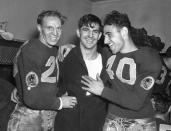 "FILE - In this Dec. 12, 1937, file photo, Washington Redskins quarterback Sammy Baugh, center, celebrates with teammates Cliff Battles, left, and Wayne Millner in the locker room after the Redskins defeated the Chicago Bears 28-21 in the NFL championship football game in Chicago. Washingtons NFL team will get rid of the name ""Redskins"" on Monday, July 13, according to multiple reports. Its unclear when a new name will be revealed for one of the leagues oldest franchises. The team launched a ""thorough review"" of the name July 3.(AP Photo, File)"
