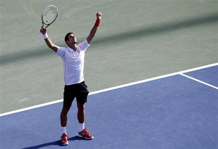 Novak Djokovic of Serbia celebrates after defeating Stanislas Wawrinka of Switzerland during their men's semi-final match at the U.S. Open tennis championships in New York September 7, 2013. REUTERS/Mike Segar