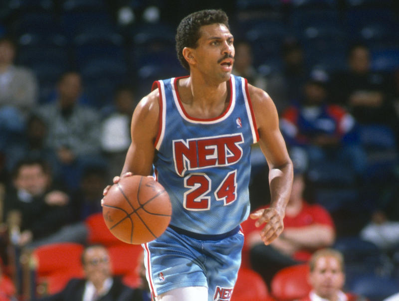 LANDOVER, MD - CIRCA 1991: Reggie Theus #24 of the New Jersey Nets dribbles the ball against the Washington Bullets during an NBA basketball game circa 1991 at the Capital Centre in Landover, Maryland. Theus played for the Nets from 1990-91. (Photo by Focus on Sport/Getty Images) *** Local Caption *** Reggie Theus