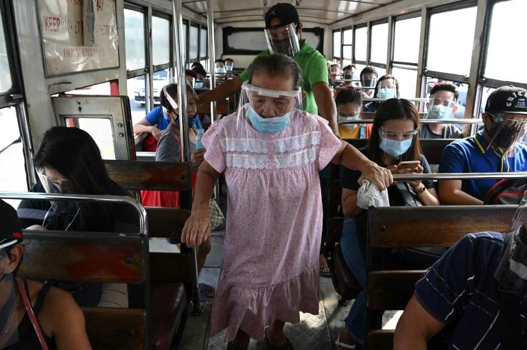 Strict mask, visor rules make Philippine commuters sweat