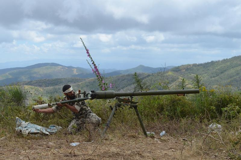A rebel fighter loads an anti-tank cannon during fighting against pro-government forces on June 1, 2014 on the outskirts of Syria's Mediterranean port city of Latakia