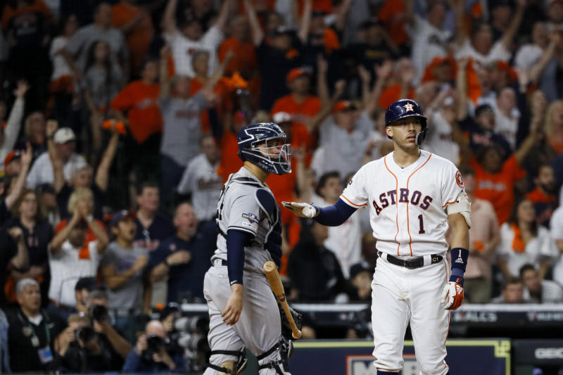 Houston Astros' Carlos Correa watches his walk-off home run against the New York Yankees during the 11th inning in Game 2 of baseball's American League Championship Series Sunday, Oct. 13, 2019, in Houston. (AP Photo/Matt Slocum)