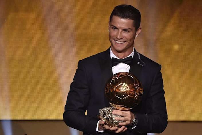 Real Madrid and Portugal forward Cristiano Ronaldo accepts the 2014 FIFA Ballon d'Or award for player of the year, at the Kongresshaus in Zurich, on January 12, 2015 (AFP Photo/Fabrice Coffrini)