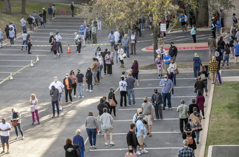 People wait in a long line to cast ballots for the general election at an early voting location at the Renaissance Austin Hotel on October 13, in Austin, Texas. Source: AP