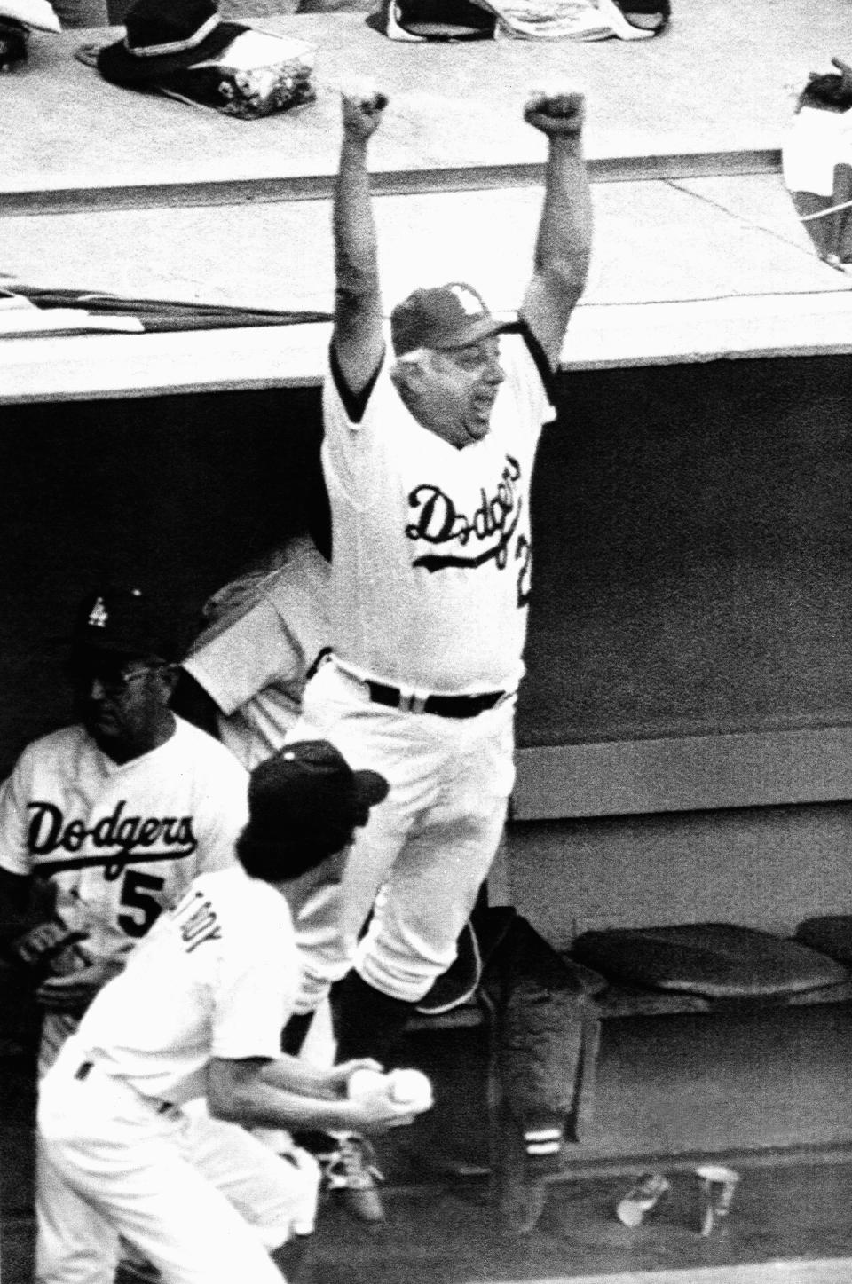 Los Angeles Dodgers manager Tom Lasorda leaps from the dugout as the Dodgers beat the New York Yankees, 8-7, to tie the World Series at two games apiece, Saturday, Oct. 24, 1981 in Los Angeles. (AP Photo)