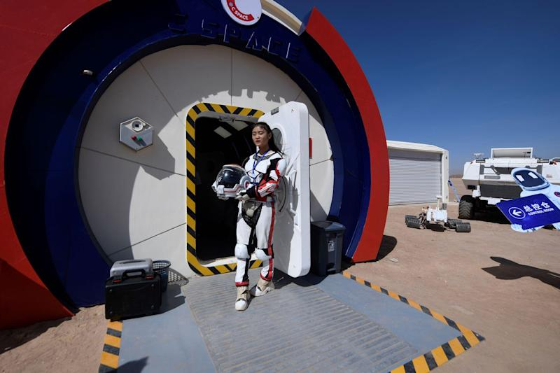 "A guide wearing a space suit stands at an entrance at ""Mars Base 1"", a C-Space Project, in the Gobi desert, some 40 kilometres from Jinchang in China's northwest Gansu province on April 17, 2019: WANG ZHAO/AFP via Getty Images"