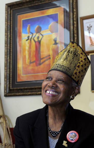 In this Feb. 17, 2010, photo, Sadie Roberts-Joseph, founder of the Odell S. Williams Now and Then Museum of African-American History, now known as the Baton Rouge African-American History Museum, poses for a portrait wearing an Egyptian headdress, in Baton Rouge, La. East Baton Rouge Coroner Beau Clark released preliminary autopsy results Monday, July 15, 2019, that show Roberts-Joseph, 75, was suffocated to death before her body was found in the trunk of a car over the weekend. (Travis Spradling/The Advocate via AP)