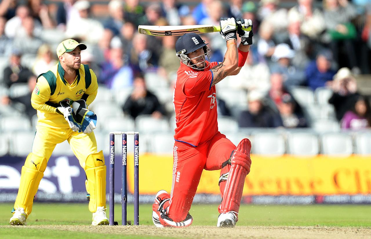 England's Kevin Pietersen hits out past Australia's Matthew Wade, during the Second One Day International at Old Trafford Cricket Ground, Manchester.