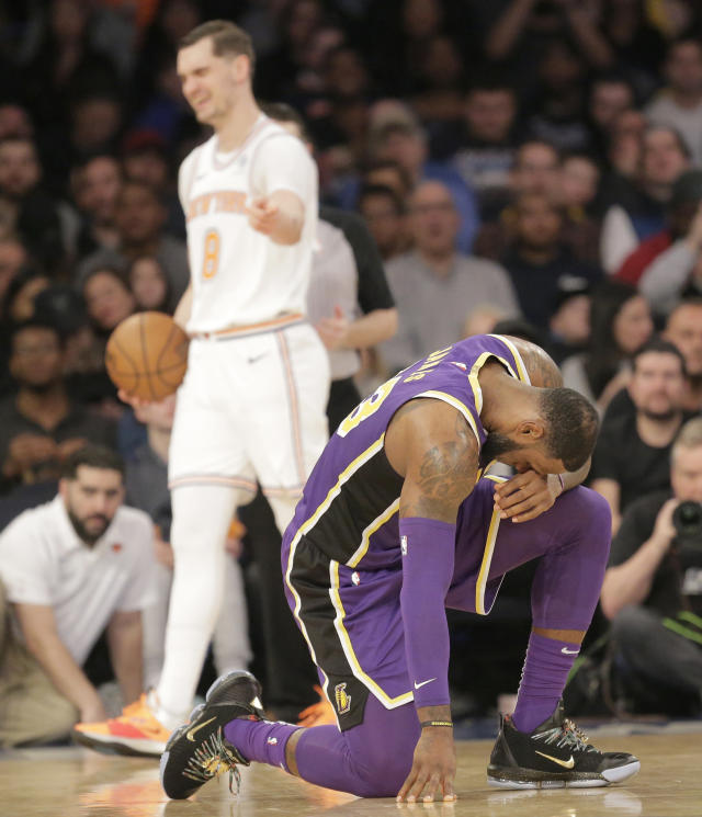 Los Angeles Lakers' LeBron James, right, and New York Knicks' Mario Hezonja react after Hezonja fouled him during the second half of an NBA basketball game, Sunday, March 17, 2019, in New York. (AP Photo/Seth Wenig)