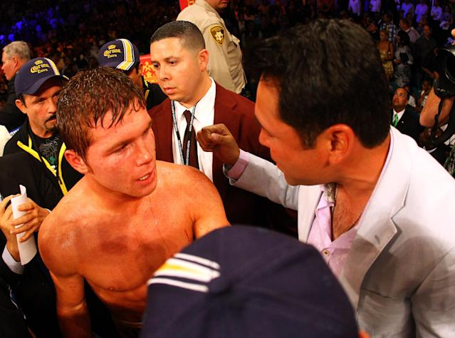 LAS VEGAS, NV - MAY 05: (L-R) Canelo Alvarez talks with promoter Oscar De La Hoya after Alvarez defeats Shane Mosley by unanimous decision during their WBC super welterweight title fight at the MGM Grand Garden Arena on May 5, 2012 in Las Vegas, Nevada. (Photo by Al Bello/Getty Images)