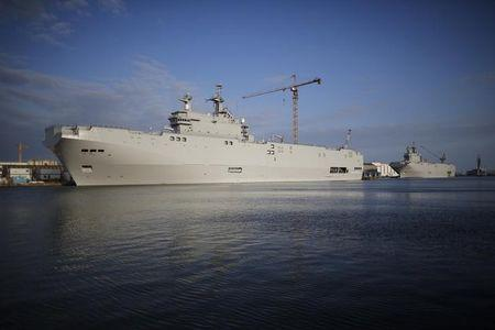 Two Mistral-class helicopter carriers Sevastopol (L) and Vladivostok are seen at the STX Les Chantiers de l'Atlantique shipyard site in Saint-Nazaire, western France