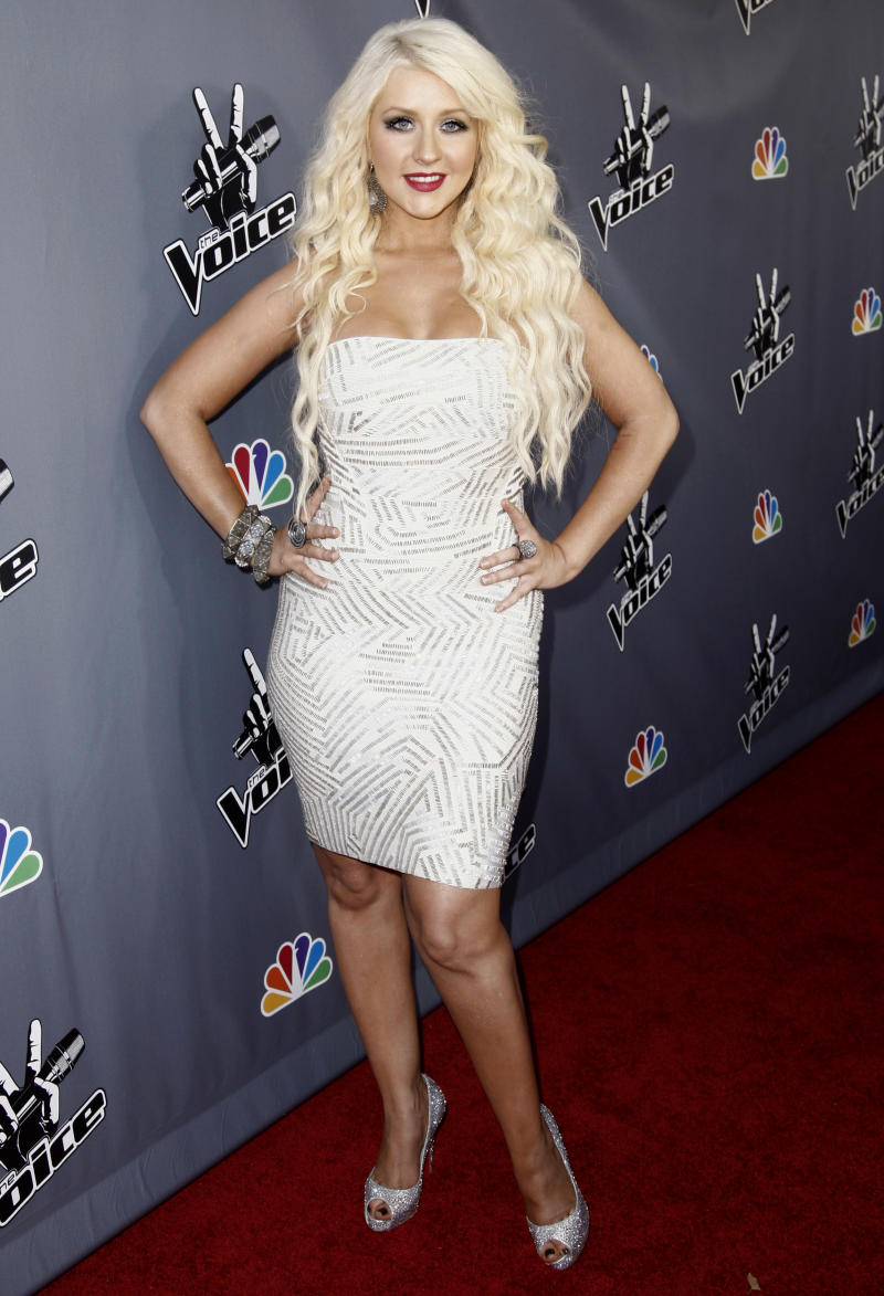 """FILE - In this June 29, 2011 file photo, singer Christina Aguilera, poses for photographers after finale of """"The Voice"""" in Burbank, Calif. Aguilera has been nominated for three ALMA Awards; for favorite female music artist, favorite movie actress in a comedy or musical for her role in """"Burlesque,"""" and favorite TV reality personality for """"The Voice.""""  The ALMA Awards will air on Sept. 16 on NBC.  (AP Photo/Matt Sayles, file)"""