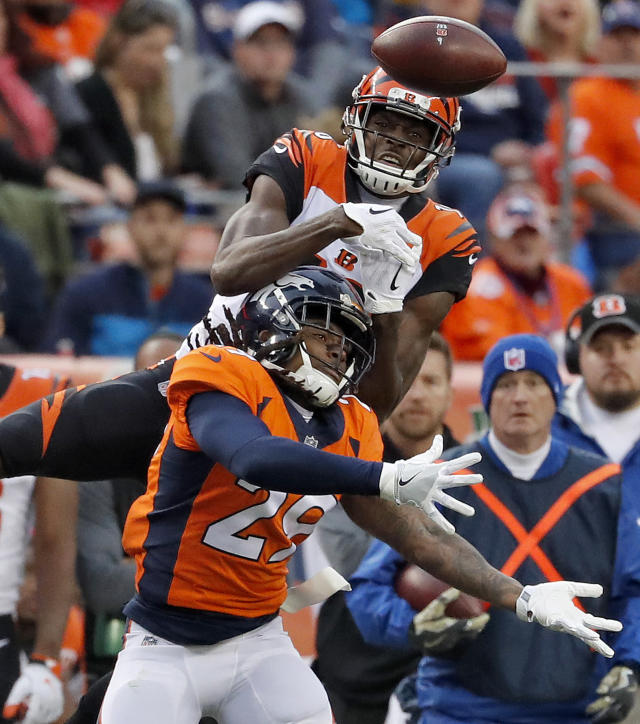 <p>Denver Broncos free safety Bradley Roby (29) breaks up a pass intended for Cincinnati Bengals wide receiver Cody Core during the first half of an NFL football game, Sunday, Nov. 19, 2017, in Denver. (AP Photo/Jack Dempsey) </p>