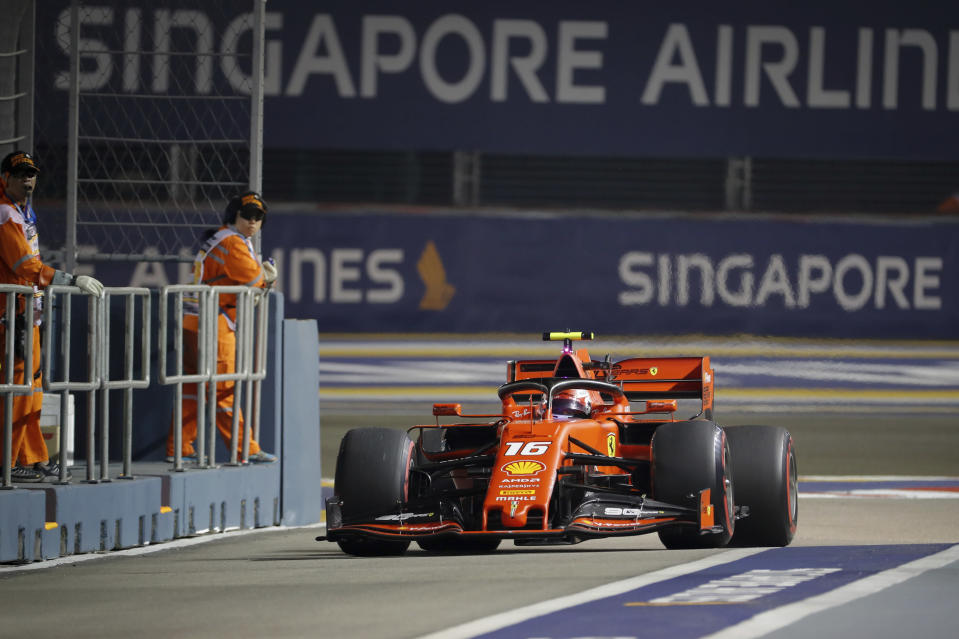 Ferrari driver Charles Leclerc of Monaco steers his car into pit-lane during the second practice session at the Marina Bay City Circuit ahead of the Singapore Formula One Grand Prix in Singapore, Friday, Sept. 20, 2019. (AP Photo/Vincent Thian)