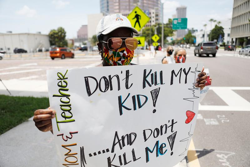 Business education teacher Malikah Armbrister took to the streets in Tampa earlier this month to protest the push for school reopenings in Florida that would include in-person instruction. (Octavio Jones via Getty Images)
