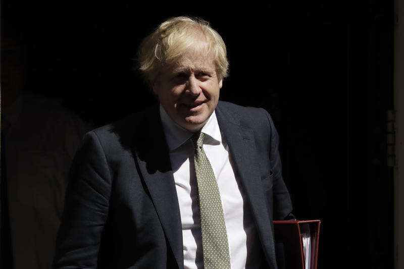 British Prime Minister Boris Johnson leaves 10 Downing Street in London, to attend his first weekly Prime Minister's Questions since recovering from coronavirus, at the Houses of Parliament, in London, Wednesday, May 6, 2020. The highly contagious COVID-19 coronavirus has impacted on nations around the globe, many imposing self isolation and exercising social distancing when people move from their homes. (AP Photo/Matt Dunham)