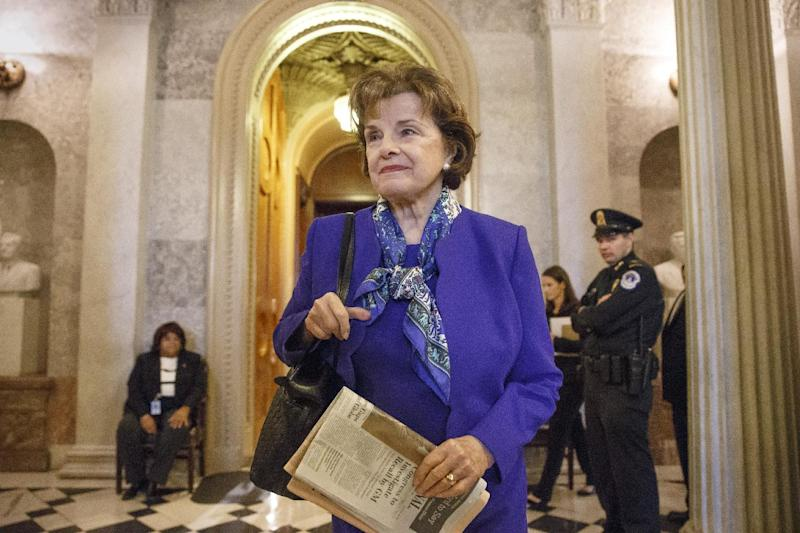 In this March 11, 2014, photo, Sen. Dianne Feinstein, D-Calif., chair of the Senate Intelligence Committee, leaves the chamber just after saying that the CIA's improper search of a stand-alone computer network established for Congress has been referred to the Justice Department, at the Capitol in Washington. A dispute between the CIA and the Senate that flared into public view this week has no obvious path toward criminal prosecution and may be better resolved through political compromise than in a court system leery of stepping into government quarrels, legal experts say. (AP Photo/J. Scott Applewhite)