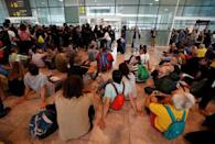 Protesters block an entrance to the airport due to a verdict in a trial over a banned independence referendum, in Barcelona