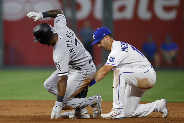 Chicago White Sox's Tim Anderson (7) is safe with a double as Kansas City Royals second baseman Whit Merrifield, right, places a late tag during the sixth inning of a baseball game at Kauffman Stadium in Kansas City, Mo., Monday, July 26, 2021. (AP Photo/Colin E. Braley)