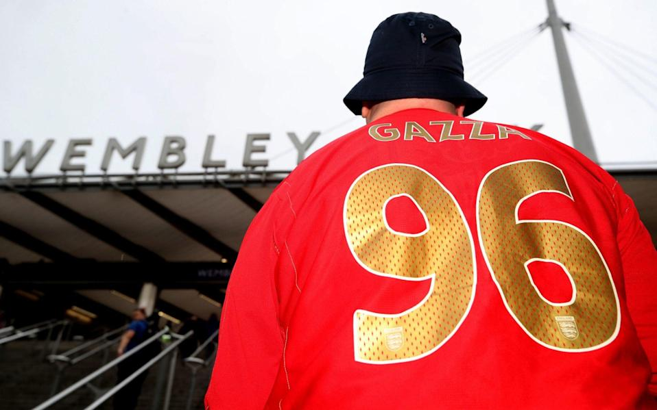 An England fan arrives for the UEFA Euro 2020 Group D match at Wembley Stadium with Gazza 96 on his shirt - Nick Potts/PA