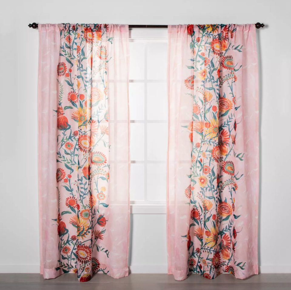 """<h3><a href=""""https://www.target.com/p/floral-daisy-light-filtering-curtain-panels-pink-opalhouse-153/-/A-54199194"""" rel=""""nofollow noopener"""" target=""""_blank"""" data-ylk=""""slk:Opalhouse Floral Light-Filtering Curtain"""" class=""""link rapid-noclick-resp"""">Opalhouse Floral Light-Filtering Curtain</a></h3><br><br>Create flexible boundaries inside a shared room or apartment with a set of stylish curtains that will still allow light to filter through — just hang a panel or two from an open door frame or ceiling to section-off your space.<br><br><strong>Opalhouse</strong> Floral Daisy Light Filtering Curtain Panels Pink, $, available at <a href=""""https://www.target.com/p/floral-daisy-light-filtering-curtain-panels-pink-opalhouse-153/-/A-54199194?preselect=54136974#lnk=sametab"""" rel=""""nofollow noopener"""" target=""""_blank"""" data-ylk=""""slk:Target"""" class=""""link rapid-noclick-resp"""">Target</a>"""